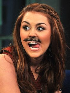 Miley Cyrus loves mustaches -- so much so that she carries around one with her at all times! The teen queen models one of her favorite styles during a visit to Late Night with Jimmy Fallon on March 3, 2011.