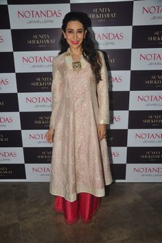 Karisma Kapoor in a Pallavi Puri look, paired the anarkali with a crimson red, wide-leg silk palazzo pant showcasing a gold zari polka-dot weave all over.