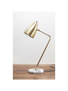 Introducing the Grodorna table lamp:  • Modern table or desk lamp.  • Spun brass cone shade. • Shade mounted rotary switch. • Heavy gauge solid