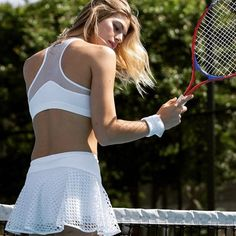 Look just as good on the court as you do on it with this Michi Deuce Tennis Skirt in white. This luxurious workout clothing fits like a dream, and is every ounce as comfortable as it looks. #skirt