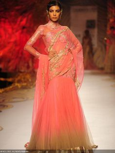 A model walks the ramp for designer Gaurav Gupta on Day 5 of Delhi Couture Week, held in New Delhi, on August 04, 2013.