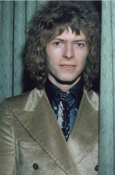 David Bowie, February 1970, at the 'Disc and Music Echo' Valentine Awards ceremony at the Cafe Royal in London. Photo: Hulton Archive/Getty Images.