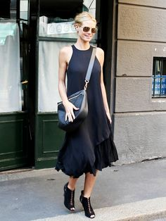 Heidi Klum wears an Elizabeth and James asymmetric dress with Sergio Rossi python booties and an Elizabeth and James half-moon shoulder bag.