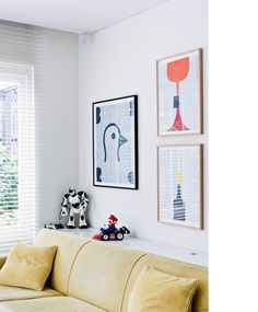 Another way to layout pictures in a lounge room - Natalie Bloom's TV room (from Design Files)