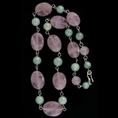 A stunning necklace of carved rose quartz ovals and fine green jadeite beads. Sterling silver hook clasp.  The rose quartz oval beads measure 21mm long in the center and 19mm long at the end of the necklace. The jade beads are 9mm.  The beads are wired in sterling silver.  These are fine quality vintage beads from a dealer's estate and  purchased in China in the 1970's. Length is 19.5  inches.  58 grams.