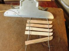 Making a picket fence:20-22 gauge craft wire Popsicle sticks or twigs Needle nosed pliers clipboard  and paint