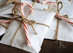 Christmas party favor bags with twine and candy cane topper. (And other gift wrapping ideas. Noel Christmas, Little Christmas, Winter Christmas, All Things Christmas, Christmas Gifts, Christmas Decorations, Christmas Candy, Christmas Ideas, Christmas Packages