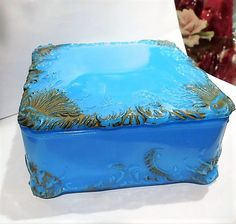 ITEM #041708  This is an antique Victorian, circa late 1800s blue milk glass footed lidded dresser/vanity box produced by the Dithridge Glass Company in New Brighton, PA anywhere from 1857-1901. The lid and base both have the number 36 impressed into the glass.  Box measures 5 1/8 squared and stands 2 3/4 tall.  Condition: Very good antique condition with typical wear due to age and handling. No chips cracks repairs. Some slight roughness around the rim, most likely from the ma...