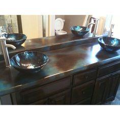 Concrete counter tops for master bath, easier double vanity, single slab.