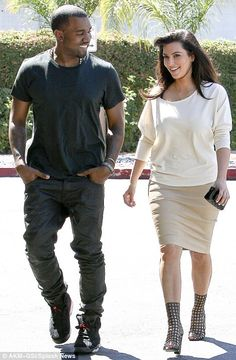 Loved up: Kim Kardashian and Kanye West only had eyes for each other when they stepped out in Los Angeles