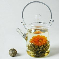 blooming tea! A delicate flower blooms inside this ball tea just before tiny flowers slowly cascade upward like Champagne bubbles. The flowers add their enlivening fragrance and strong taste to this delectably smooth green tea