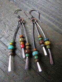 Dark patina copper spikes were hammered, textured and then I strung a rustic bead mix on each one. Very colorful and they give off lots of sparkle and movement. They hang right at 3 inches long from hand forged copper ear wires, but can be changed out with sterling if needed. Just
