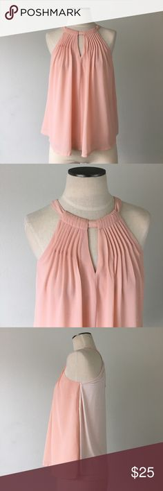 """Anthropologie-Sunday in Brooklyn Peach Pleat Top Anthropologie-Sunday in Brooklyn Peach Pleat Top. Front is a chiffonlike material fully lined (100% polyester), and back is a light pink stretchy soft knit (95% cotton, 5% spandex). Clasps with a button in the back (keyhole). Flowy fit. About 24.5"""" long from shoulder to hem. Armpit-armpit is about 16.5"""" laid flat. Great condition. Size XS Anthropologie Tops"""