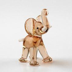 cute elephant glass figurine.... lucky elephant with trunk in air for office or home
