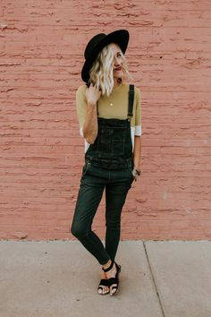 Overalls in Dark Wash 5 Pocket Cut w/ Chest Pockets Skinny Jean Fit w/ Elastic Waist Adjustable Straps w/ Gold Buckle Detail Side Zipper Subtle Distressed Detail Paired with Color Block Top View Size Chart