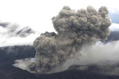 A volcano in southern Japan blasted out chunks of magma Friday in the first such eruption in 22 years, causing flight cancellations and prompting warnings to stay away from its crater.