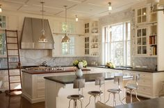 Kitchen - stools, backsplash, hood, lighting, ladder