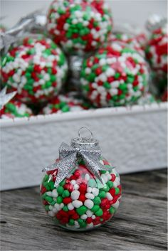 If you are looking for a simple holiday decorating or gift idea, I've got the perfect one, and it's so easy that kids can do it. The directions for making these candy filled ornaments is over at the Nestlé site Simply Celebrate. Noel Christmas, Homemade Christmas, Diy Christmas Gifts, Christmas Treats, Christmas Projects, Winter Christmas, Christmas Ornaments, Christmas Party Favors, Christmas Party Decorations Diy