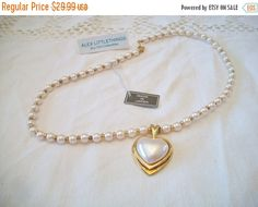 Your Vintage Heart.  https://www.etsy.com/listing/287308881/vintage-pearl-heart-necklace-japan