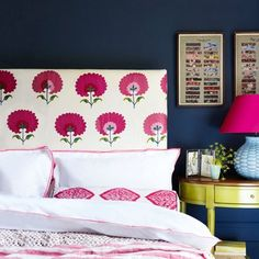 Decorating with dark paint doesn't mean you'll end up with a room of Stygian gloom. In fact the very opposite. Used properly drama and atmosphere await. Like this bedroom, where bright pink and white make for a cheerful scheme.