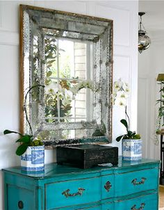 ADORE the turquoise chest and that mirror is STUNNING!