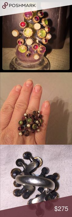 Handmade unique silver and semiprecious stone ring This Ring is so cool! Hand made with amethyst, peridot, garnet polished stones and some type of pearls. This was bought from an Italian jewelry craftsman in Los Angles. Adjustable. Very special art Jewelry Rings