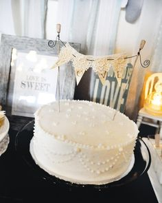 Love is All You Need- lace and whites (would look nice on fellowship hall's blue walls) love-bridal-shower-cake-bunting