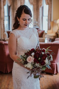 Burgundy red wedding bouquet with wax flowers and dahlias