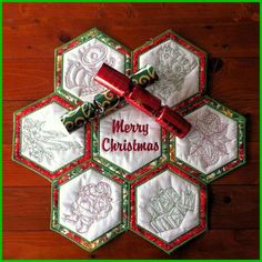 In the Hoop machine embroidery design. Hexagon Christmas table mat.