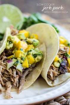 Slow Cooker Jerk Pork with Caribbean Salsa at http://therecipecritic.com  One of the BEST pork recipes with amazing spices and the caribbean salsa on top is amazing!