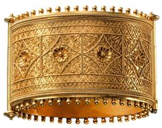 Gold Greek and Etruscan Revivalist hinged bangle, maker unknown, 1880 to 1885.