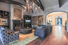 Spieth's new living room features an opulent chandelier, walnut floors and furniture cente...
