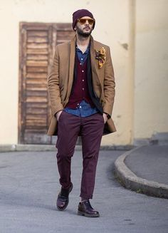 Shop this look on Lookastic:  http://lookastic.com/men/looks/beanie-denim-shirt-pocket-square-cardigan-blazer-overcoat-chinos-derby-shoes/8767  — Dark Purple Beanie  — Blue Denim Shirt  — Yellow Print Pocket Square  — Burgundy Cardigan  — Black Blazer  — Camel Overcoat  — Dark Purple Chinos  — Dark Purple Leather Derby Shoes