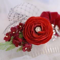 red flower headpiece, rockabilly wedding hair accessory, burlesque fascinator, rhinestone and flower hair comb, bridal hair flower. via Etsy.