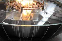 The Seattle Gas Fire Bowl was inspired by the Seattle Space Needle. It is powered by the PF50 18kw CE-approved gas burner. This unit was built with a toughened glass tape top and midnight black powder-coated base. It was built and installed for a private client in Portugal and was supplied with our unique black diamond fuel bed.