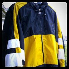 Nike hooded** Men Size Large Jacket Nike hooded** Men Size Large** Jacket Blue white yellow colors very great condition!  Jogging like material. Nike Jackets & Coats