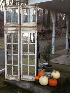 Vintage restored window panels Mirrors installed in lower section Decorative Home  Decor for French Country or Shabby Chic. $300.00, via Etsy.