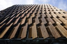 Set the controls for the heart of the sun: recycled, programmable timber shutters on the City of Melbourne's CH2 building. City of Melbourne