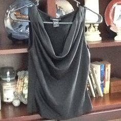 Express Hot Top! Express black poly/ spandex, loose neck and gathered tank top. Stretchy and wicked comfy. Classic addition to your closet, many options for outfits. Great condition! Express Tops