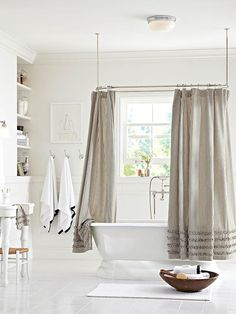 Add some interested with a striped shower curtain. #potterybarn
