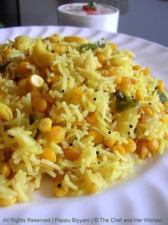 Indian Chana Dal Rice - in a rice cooker this is absolutely easy,one cup dal and two cup basmati rice,olive oil, garlic, onion, ginger,chives,some cilantro and its done.