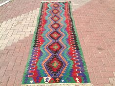 50 years old, vintage kilim rug was made in western Turkey using all hand spun natural wool. Hallway runner in great vintage condition. Sizes are 125 x 39.5 or 317 cm x 100 cm  Worldwide shipping from Turkey. Estimated shipping time is 3-6 days..