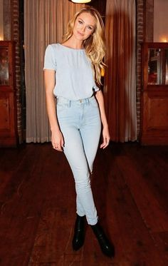 Candice Swanepoel in a lightwash denim jeans and tee