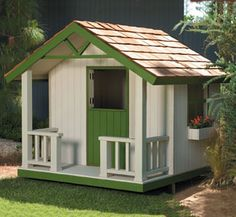 Cottage Playhouse. I wonder if Dan could build this. Maybe add some lil window flower boxes for my princess :)