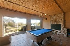 Lovely entertaining home with games room and indoor braai, pool and table tennis table.Open plan lounge dining area and kitchen with fire Bedr. Tennis Table, Buy And Sell Cars, Built In Cupboards, Shared Bedrooms, Holiday Accommodation, Open Plan Kitchen, Game Room, Dining Area, Beautiful Places