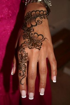 henna hand finger tattoo