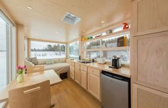 Inside, the space comprises a living area, compact kitchen and bathroom with a shower, all decorated... - Escape Traveler