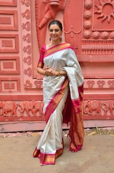 A classic white silk sari with red border.