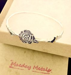 Sterling Silver Run for the Roses Bangle Bracelet by MaedayMetals on Etsy https://www.etsy.com/listing/469299330/sterling-silver-run-for-the-roses-bangle