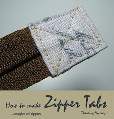 Find out how to add zipper tabs to the end of your zippers. A great way to finish off zippers on the ends of zippered pouches. This tutorial will show you how easy they are to make ~ Threading My Way